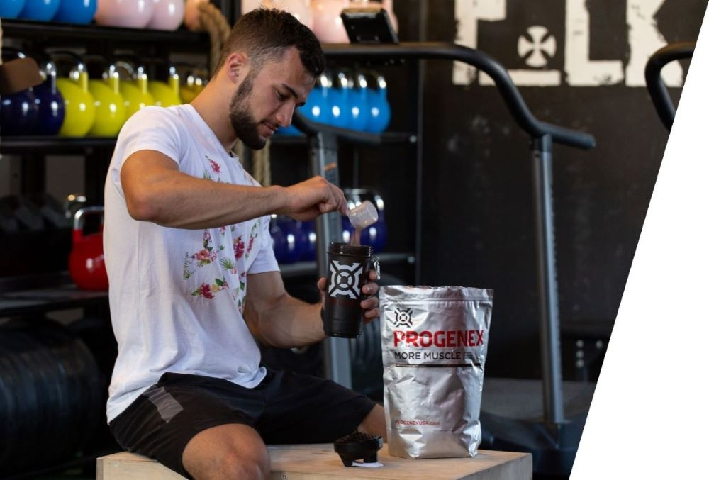 Athlete-preparing-to-drink-protein-shake-Progenex-More-Muscle
