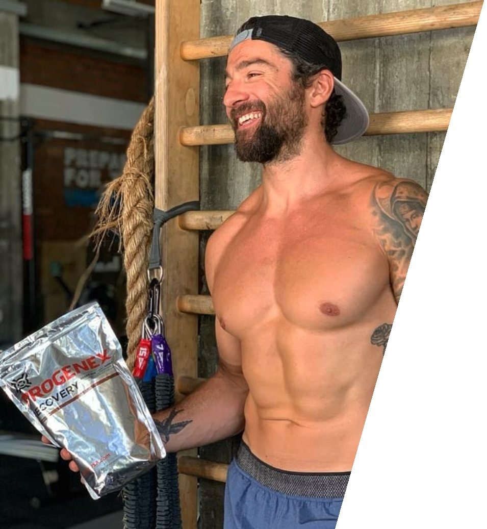 Functional fitness athlete Christos Tampakos holding a bag of Progenex Recovery hydrolized whey protein isolate